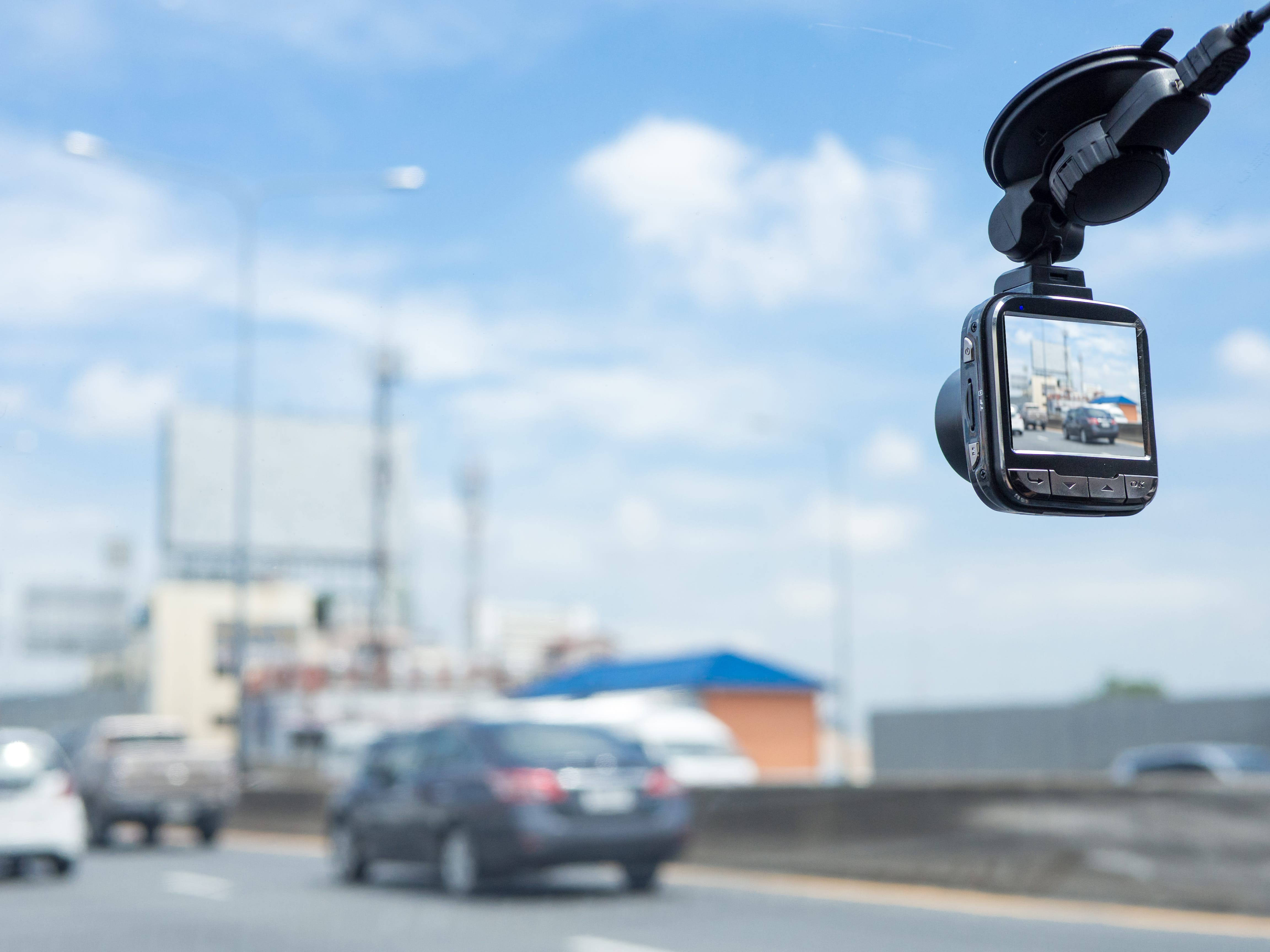 A dash cam recording the road in front.